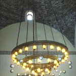 cool chandelier & domed ceiling in dining area