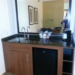 Wet bar area with mini fridge
