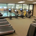 Fitness center with lap pool in background