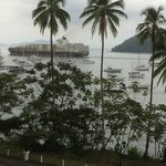 Sitting on balcony enjoying the view of ships on the Panama Canal
