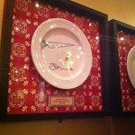 Monsoon Poon's celebrity plate wall.