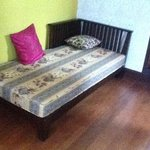 the defining element of a suite - an uncomfortable day bed squeezed into the corner of a small,