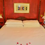 Bed decorated with rose petals