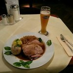 Typically Bavarian - pork roast, sauerkraut and dumplings, with wheat beer.