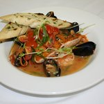 Seared Salmon Atop A Halibut Stock & Tomato Bouilloibase With Shrimp & Mussels & A Tomato Salsa