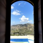 view from bedroom to the pool and surrounding mountain side