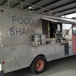 Food Shark under the shed by the railroad tracks