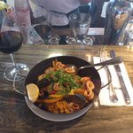 Paella with wine