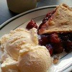 Cherry pie with vanilla ice cream.
