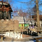 Life sized chess board, Fairy Tale Village to the right, Cinderella's Coach House to left