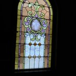 Cinderella's Coach House - stained glass windows in suite - GORGEOUS with the morning light!