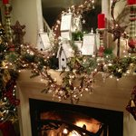 Christmas decor over the fireplace.