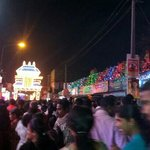 a temple lit up and alleppey market at rush hour