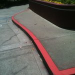 Black and red curb that the manager could not understand that existed on the property