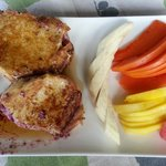 French toast stuffed with fresh berries and a side of local fruit
