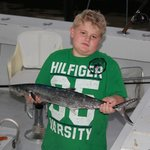 My son with his king fish aboard lady pamela