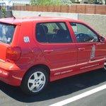 """"""" Big Red """" courtesy car."""