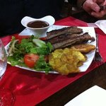 pork ribs with salad and fried yucca