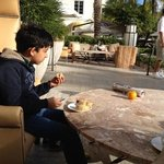 josh having breakfast on terrace