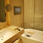 Luxury bath with a TV on the wall
