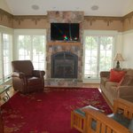 LOVE the fireplace and leather couches!