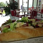 filled baguette with roasted chicken, brie & cranberry sauce.