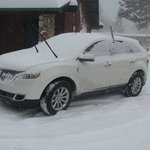 My Wifes new Lincoln covered in snow!