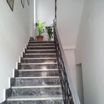 Stairs from entrance to rooms. No lift. Down to owners residence.
