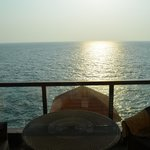 the sun setting in arabian sea
