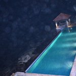 view of swimming pool in night from room