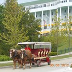 Horse drawn carriage leaving the Grand