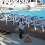 Best friend Moses getting beach area ready in the morning. moses is also security on the beach.