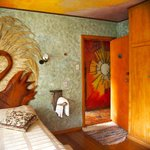 One of the bedrooms, beautifully decorated with original art and carvings