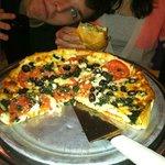 "My son ""photobombs"" my Greek Pizza"