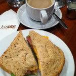 tuna sandwich and coffee with milk