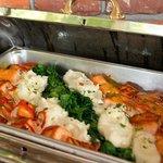 Pan seared Scottish salmon, potato puree, baby spinach, lemon beurre blanc