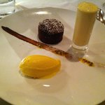 chocolate fondant (described on the menu as Chocolate biscuit) with passion fruit sorbet