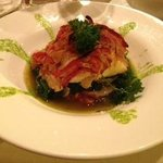 Bacalao House-cured codfish with onion and pepper comfit over sautéed baby spinach