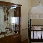The nursery with the Davis children's clothes on display
