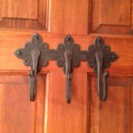 Cool iron work on the back of the bathroom door