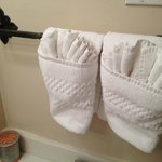 The house keeping staff folds the towels in a charming way