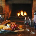 Relax with a cheese platter and bottle of Stonehurst red in front of the fire