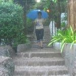 Our host braves the waterfall stairs after 3 days of rain!