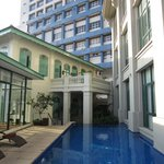 Small pool is an oasis of calm among the tall buildings surrounding the hotel