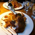 goose leg with pear and champagne cabbage