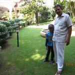 Dhinesh with Mr Fernandez at the well manicured garden.