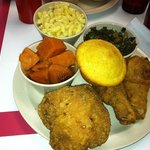 Delicious! Greens, mac & cheese, corn bread, fried chicken & candied yams.