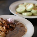Chicken satay and lontong (rice cake)