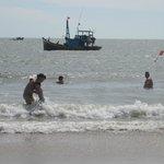 Quaint Vietnamese fishing boats keep watch in the beach area.