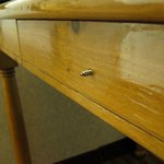 Large screw sticking out of desk drawer